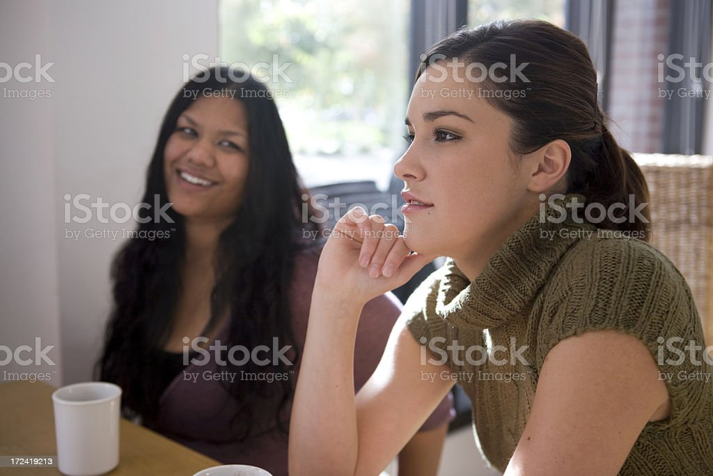 Asian Indian and Caucasian Friends Talking in Coffee Shop, Candid stock photo