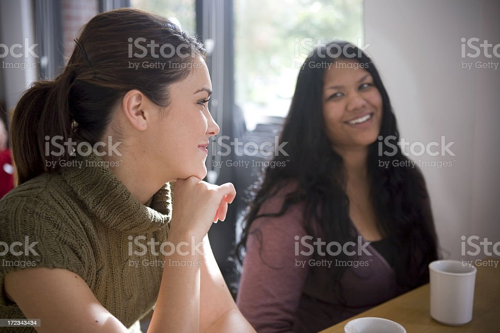 Asian Indian and Latina Young Women Friends Talking, Coffee Shop stock photo