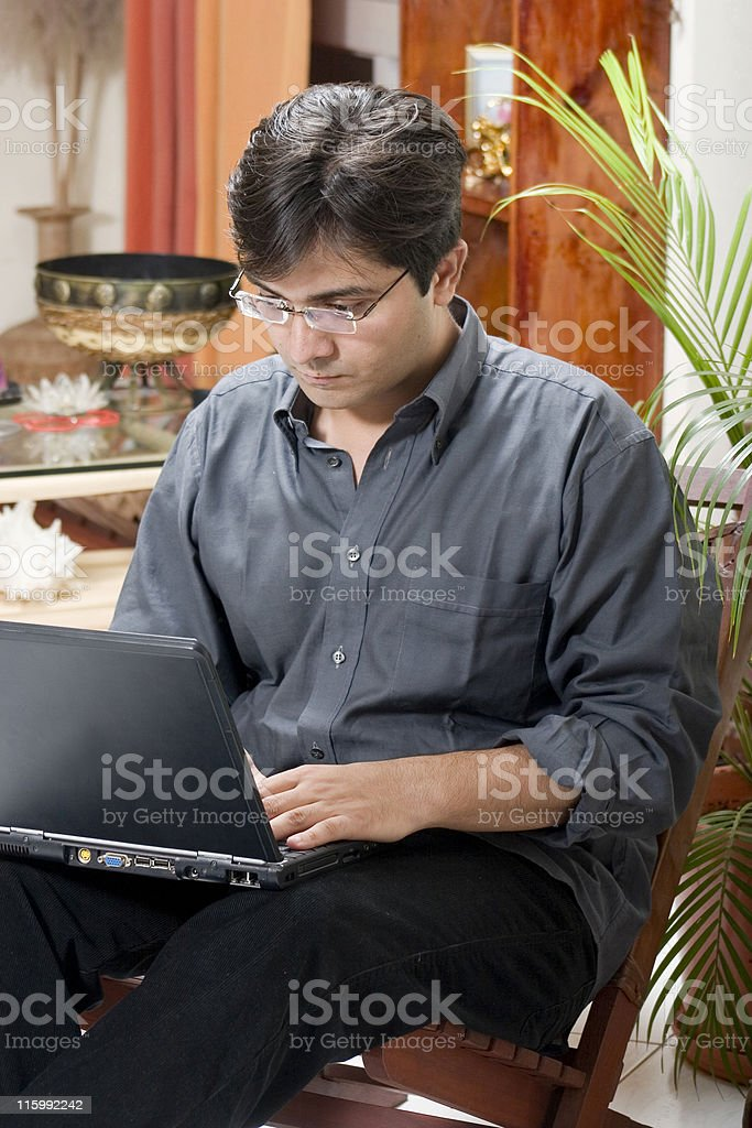 Asian Indian Man male Working from home laptop vertical people royalty-free stock photo