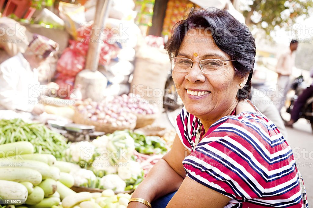 Asian Indian Senior Woman Buying Vegetables from the Street Market royalty-free stock photo
