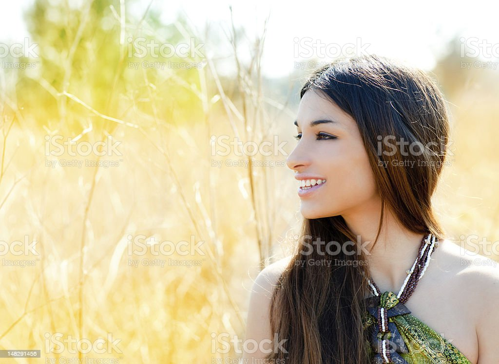 Asian indian woman profile portrait in golden field royalty-free stock photo