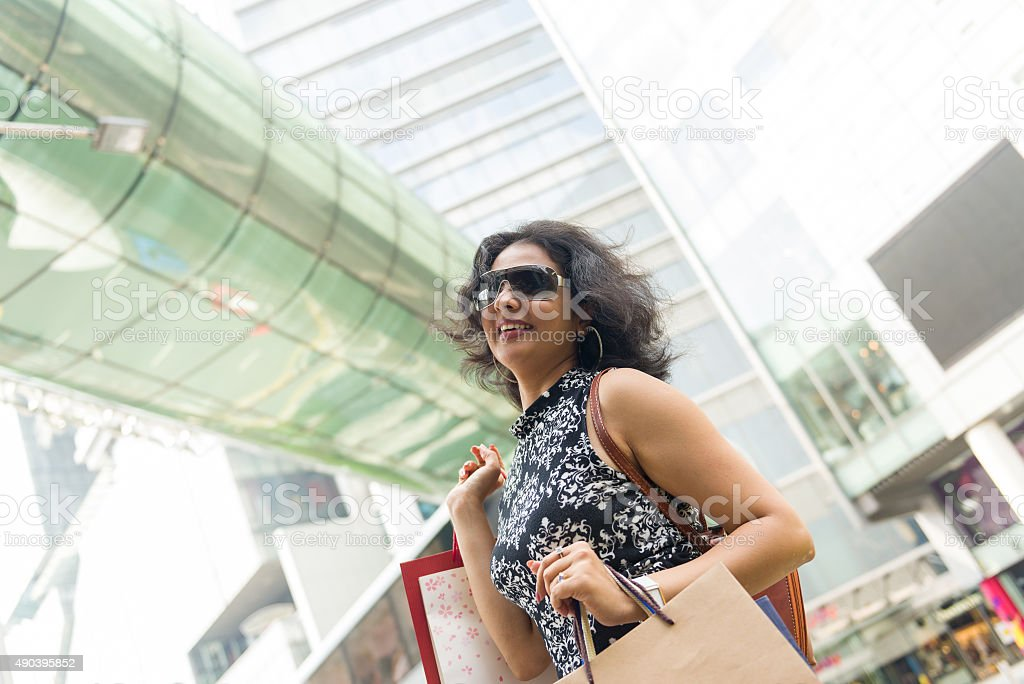 Asian Indian Woman Shopping at Shopping District stock photo
