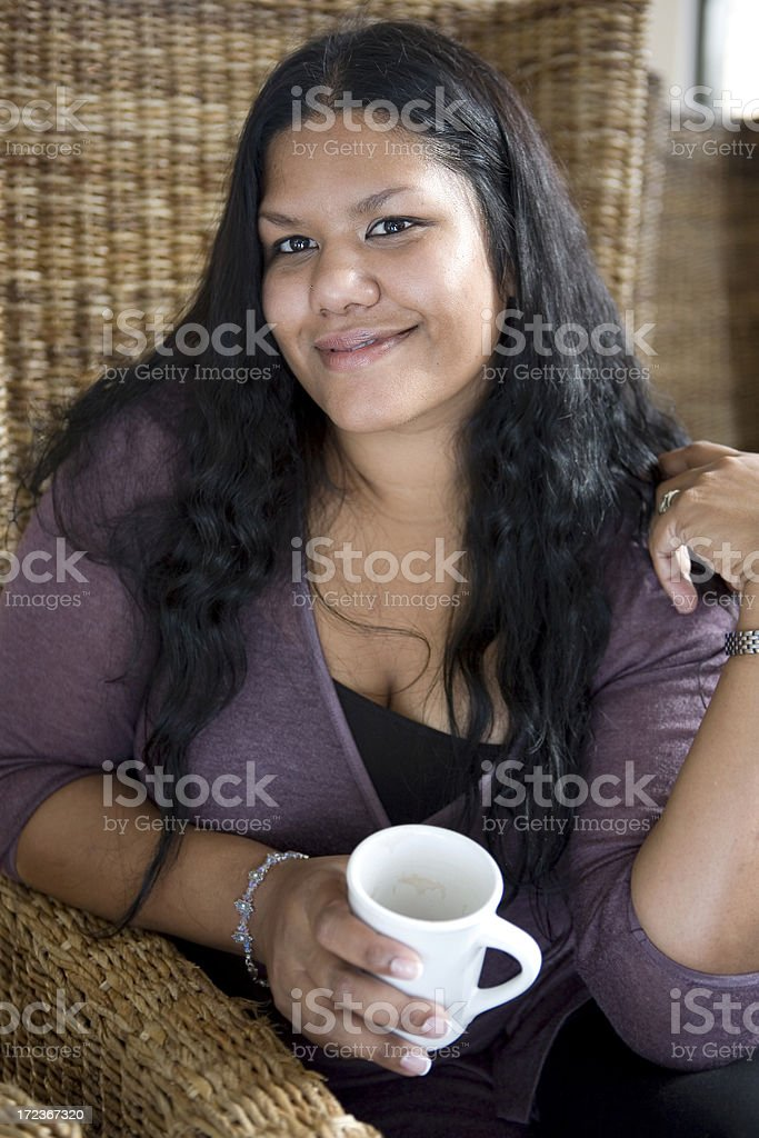 Asian Indian Young Woman Hanging Out in Coffee Shop royalty-free stock photo