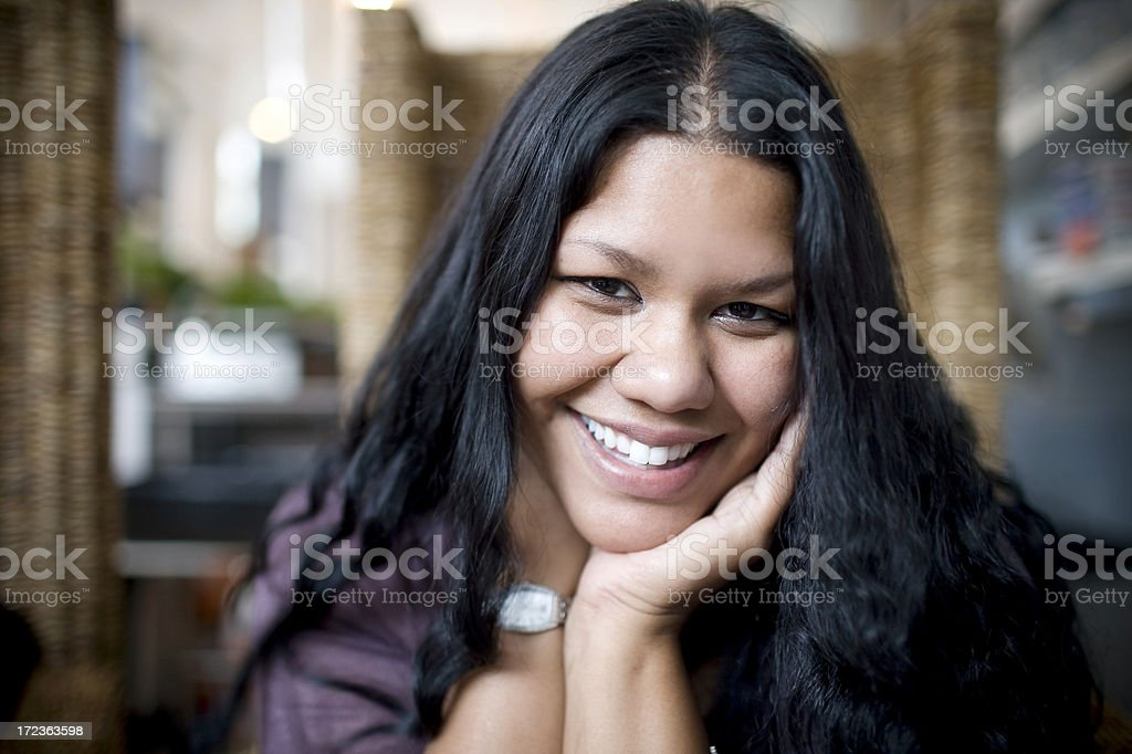 Asian Indian Young Woman Portrait at Cafe, Chin in Hands stock photo