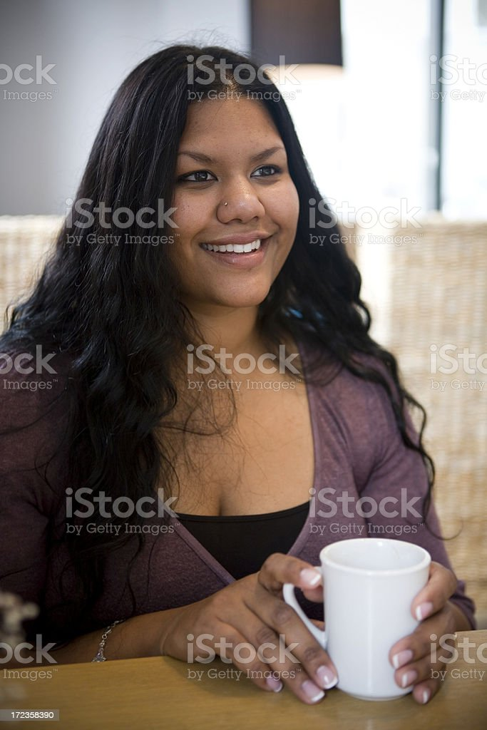 Asian Indian Young Woman Smiling in Cafe, Talking with Friend royalty-free stock photo