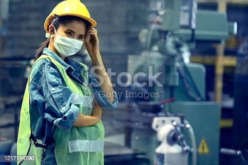 asian Industrial woman works with a face mask. Safety for work concept. Top Half of body composition.
