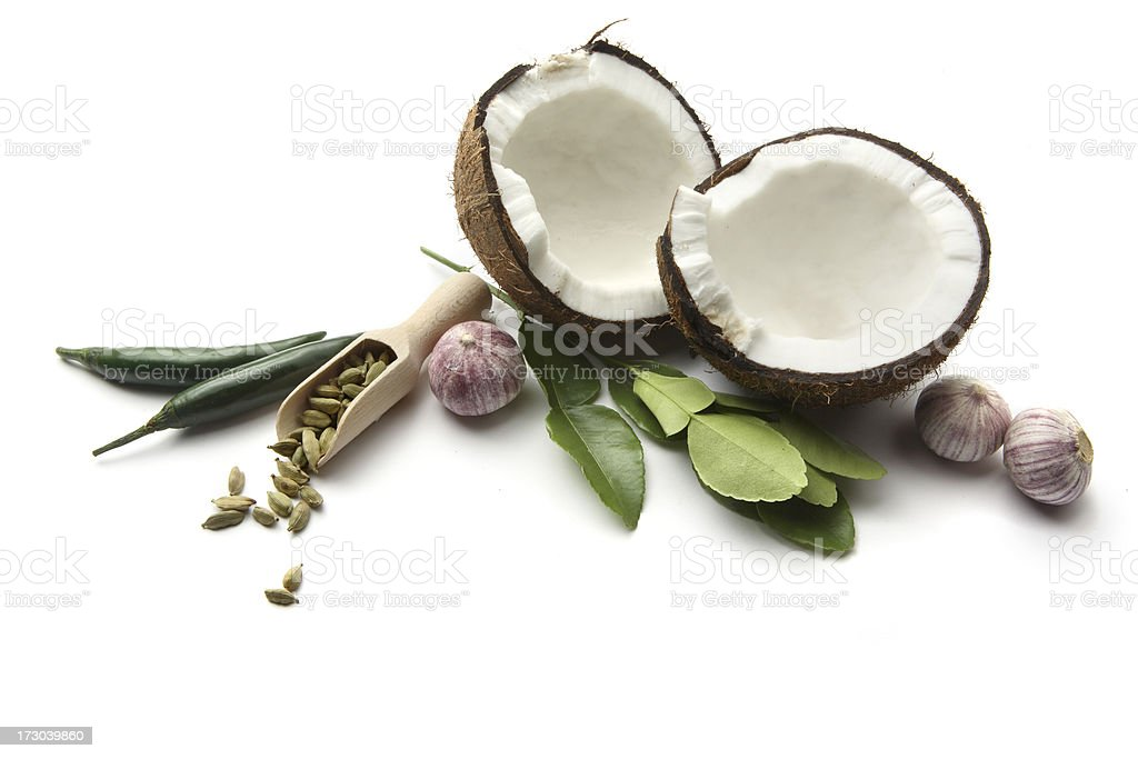 Asian Ingredients: Coconut, Cardamom, Garlic, Lime Leaf, Chili Pepper royalty-free stock photo