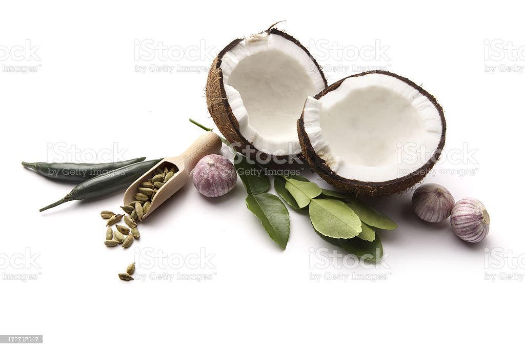 Asian Ingredients: Coconut, Cardamom, Lime Leaf, Garlic, Green Pepper royalty-free stock photo