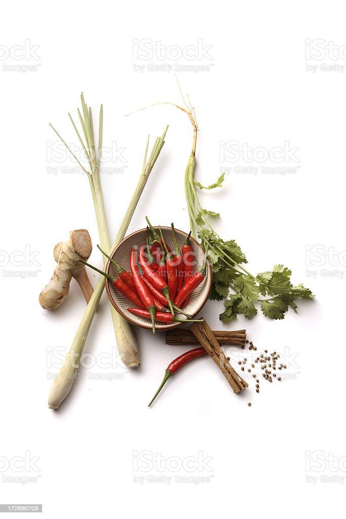 Asian Ingredients: Galangal, Lemon Grass, Coriander, Cinnamon, Chili Peppers royalty-free stock photo