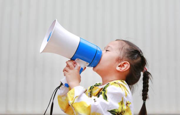 Asian kid girl shouting through megaphone communication concept picture id869974386?b=1&k=6&m=869974386&s=612x612&w=0&h=0bvkk4rc1ej7eew8 kvkvyiesvrhxaqwjxwh0aajubm=