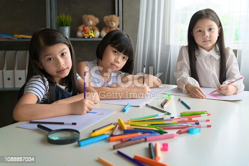818533812 istock photo Asian Kid in Creative Art workshop at school. 1088887034