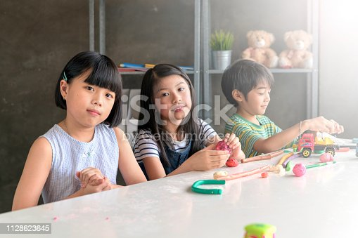 818533812 istock photo Asian Kid in Creative Art workshop at school. 1128623645