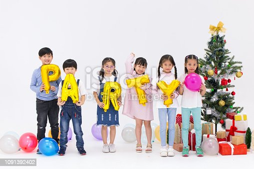 865399512istockphoto asian kids group christmas new year party isolated on white studio. 1091392402
