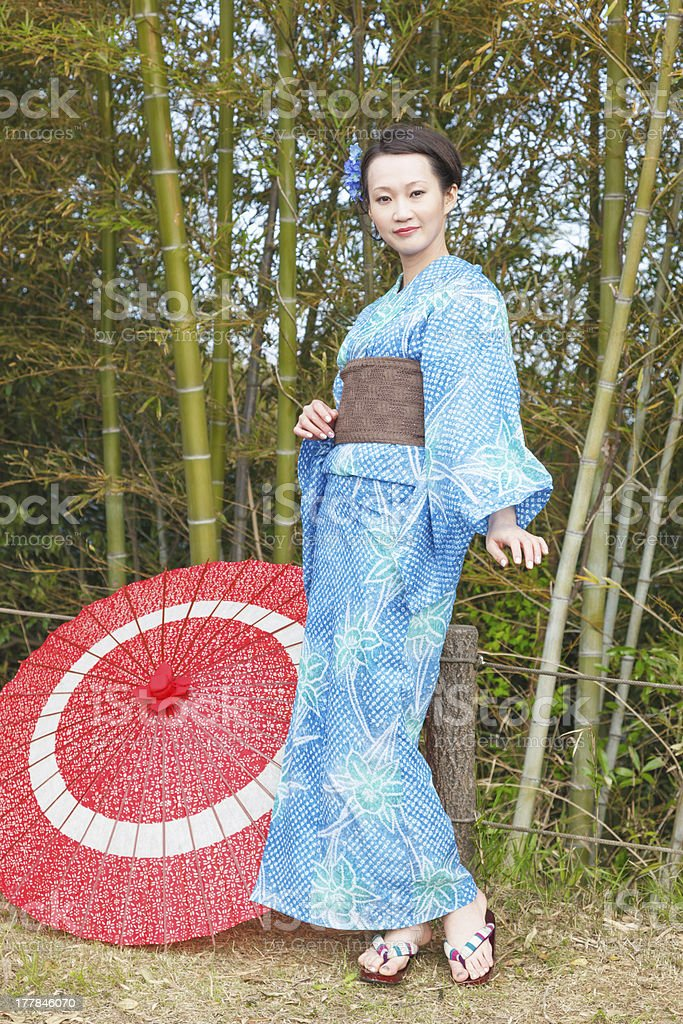 Asian kimono woman with bamboo grove royalty-free stock photo