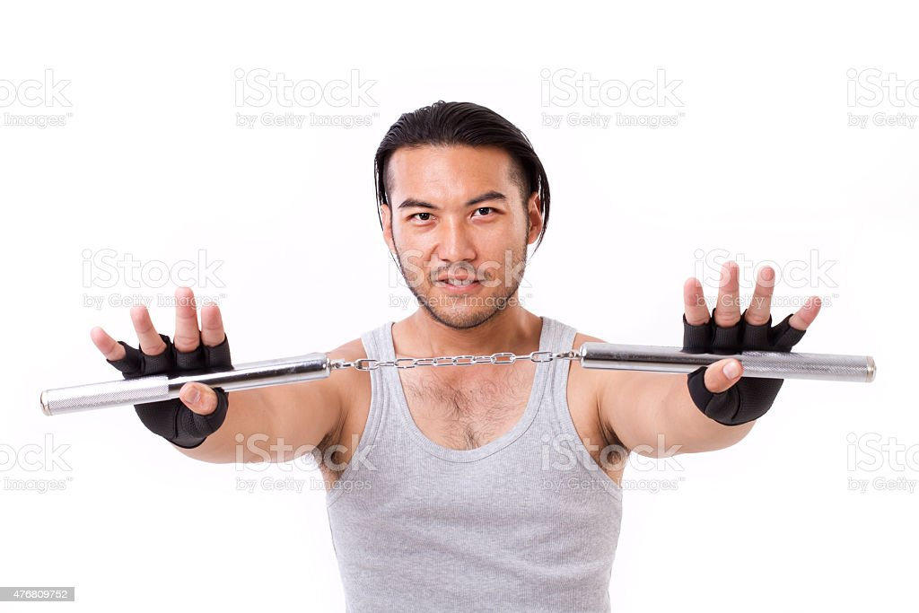 asian Kung Fu man with chainsticks or nunchaku stock photo