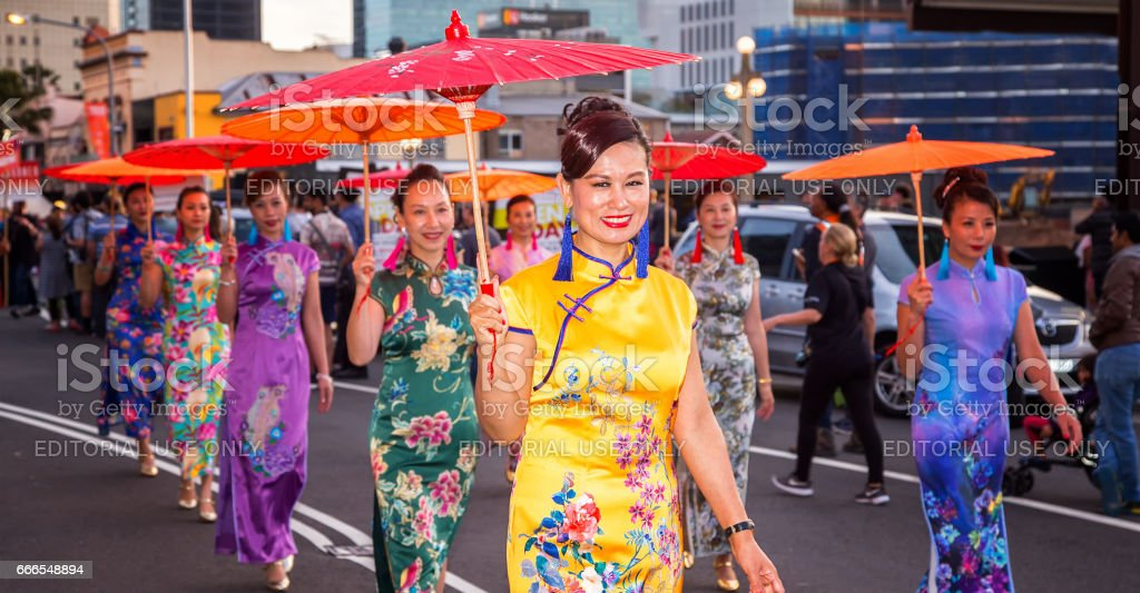 Asian ladies with parasols in a Sydney multicultural festival stock photo