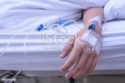 istock Asian Lady Hand received a Saline Solution injection 664144386