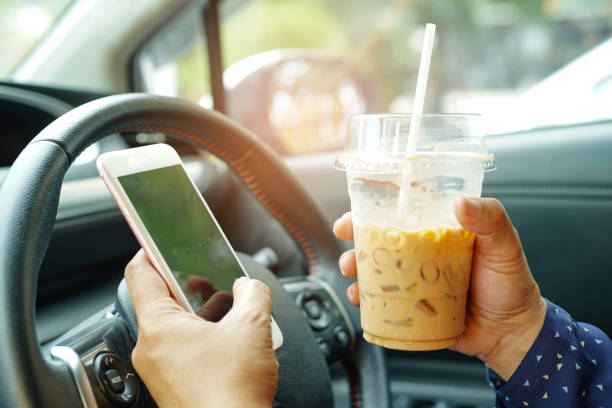 asian lady holding ice coffee and mobile phone at car to communication with friends in happy hot holiday. - detraction stock pictures, royalty-free photos & images