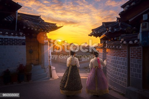 istock Asian lady in Hanbok dress walk togather in Korea old city 950333002