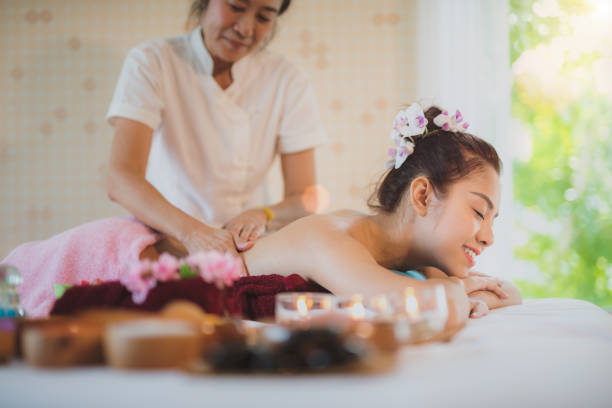 asian lady relax in skin care aroma therapy and  scrub spa - thai massage stock photos and pictures
