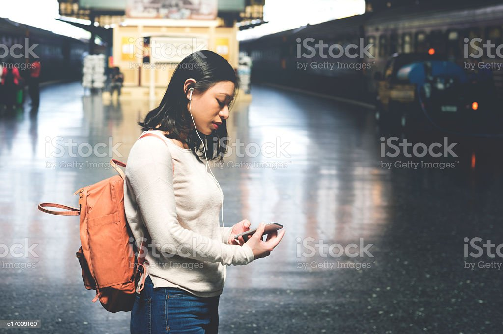 Asian Lady Traveling Commute Train Concept stock photo