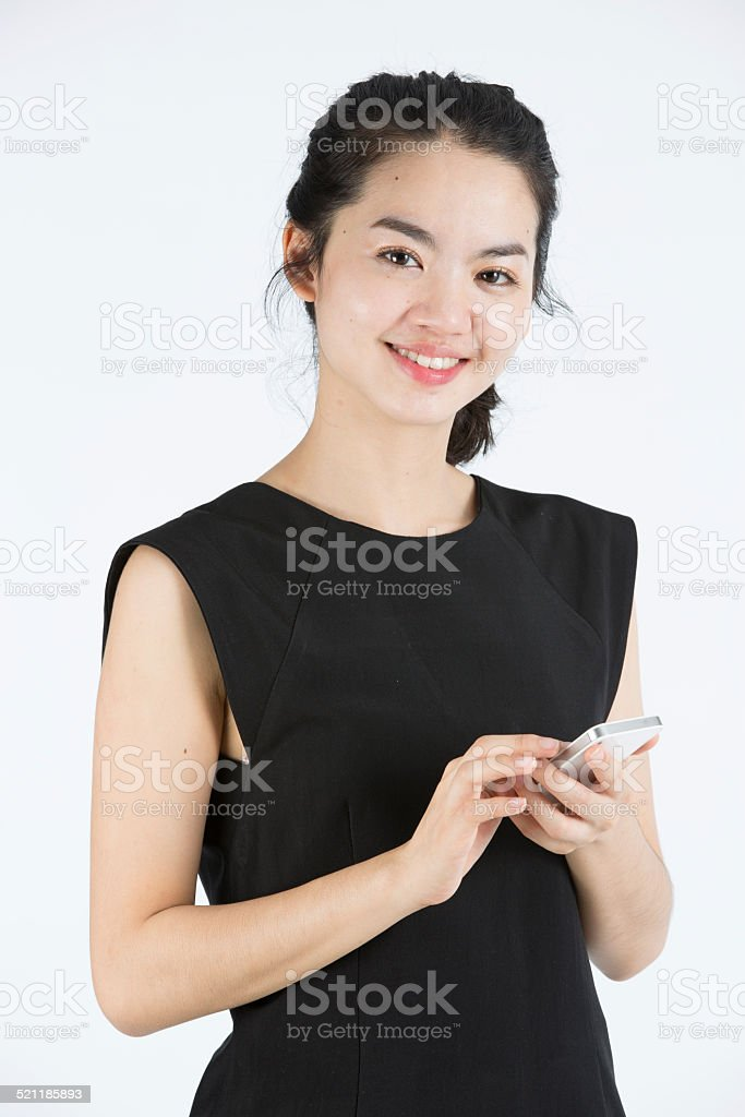 Asian lady using a mobilephone stock photo