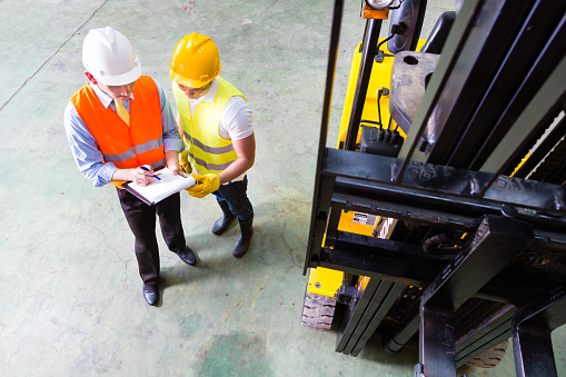 Asian Lift Truck Driver And Foreman In Storage Stock Photo - Download Image Now