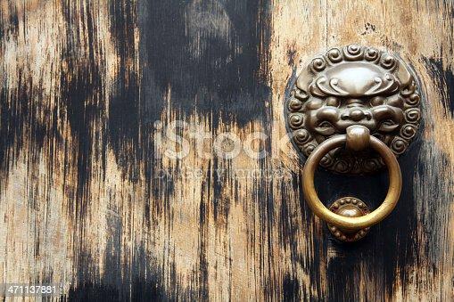 istock Asian Lion Door Knocker on Black Background 471137881