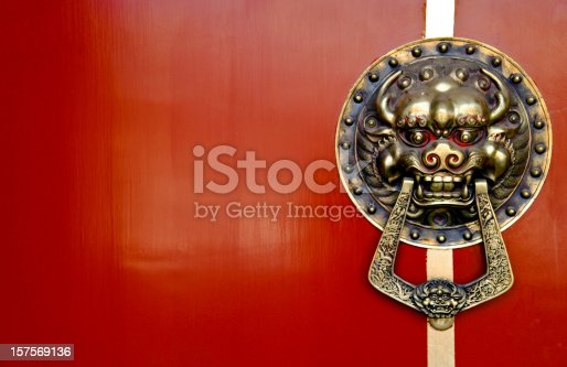istock Asian Lion Door Knocker on Red Background 157569136