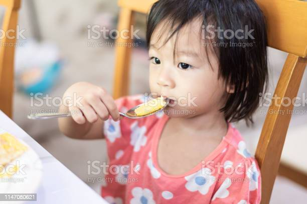 Asian little baby child eating and enjoy breakfast by herself picture id1147080621?b=1&k=6&m=1147080621&s=612x612&h=nzzpxrrx8yvligigep5 aoqwyubpftwzb91d16db000=