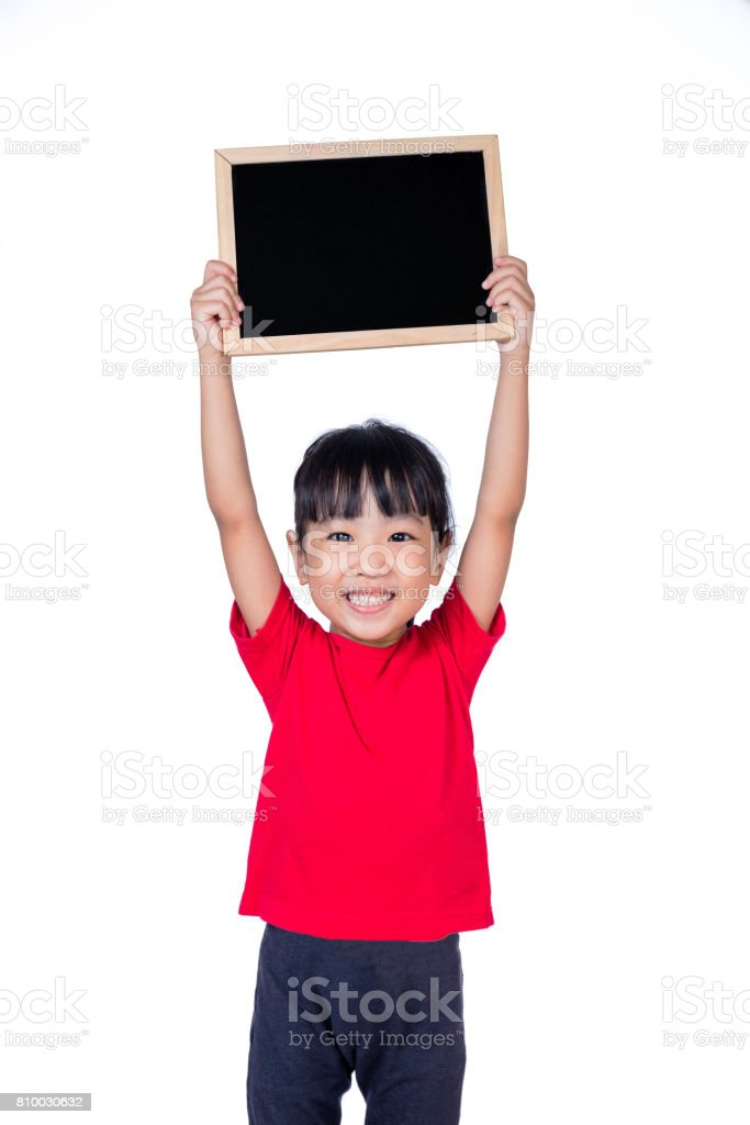 Asian little Chinese girl holding a blackboard stock photo