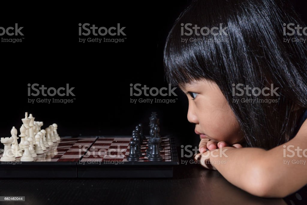 Asian Little Chinese girl playing chess royalty-free stock photo