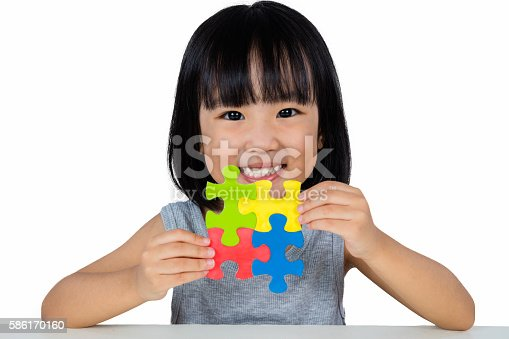 514261930 istock photo Asian Little Chinese Girl Playing Colorful Puzzle 586170160