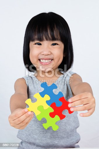 istock Asian Little Chinese Girl Playing Colorful Puzzle 586170228