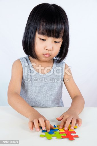 514261930 istock photo Asian Little Chinese Girl Playing Colorful Puzzle 586170624