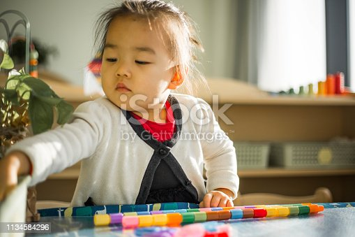 istock Asian Little Chinese Girl Playing 1134584296