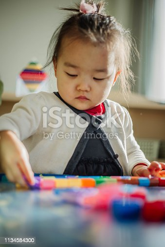 istock Asian Little Chinese Girl Playing 1134584300