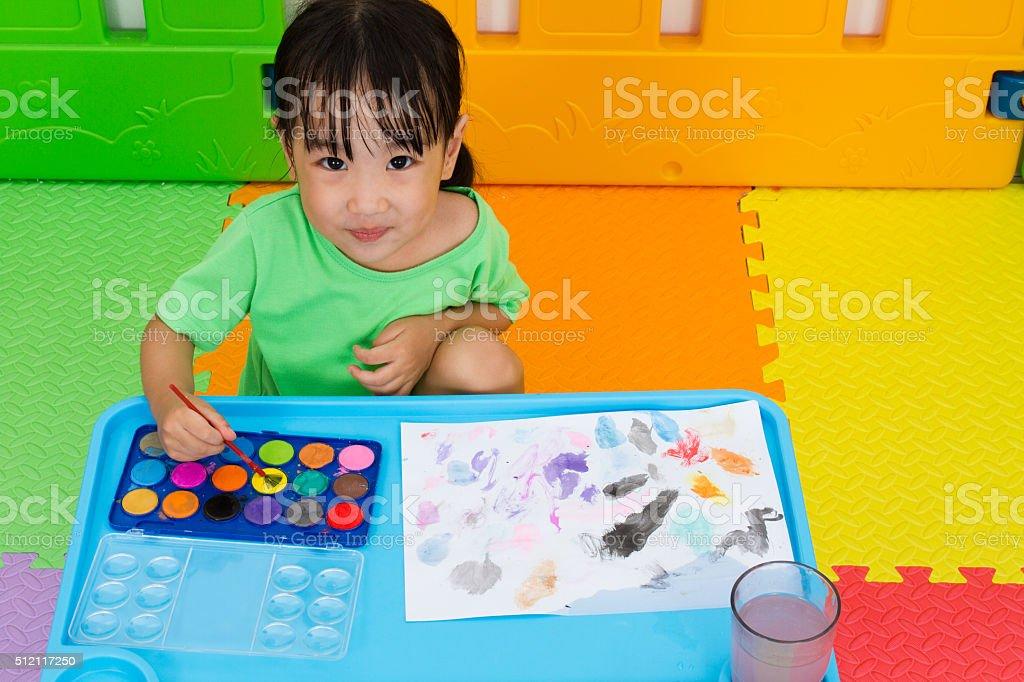 Asian Little Chinese Girl Washing Painting Brush stock photo