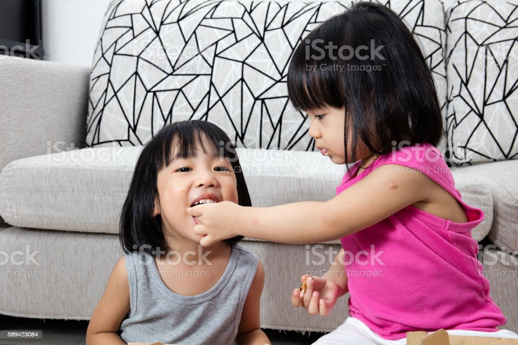 Asian Little Chinese Girls Eating Pizza stock photo