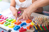 istock Asian little girl is learning English letters. 1151510733