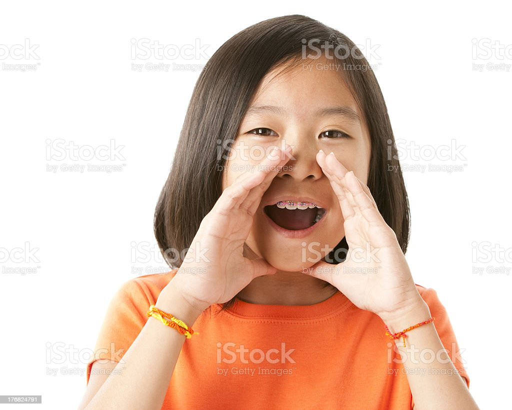 Asian Little Girl is Yelling or Cheering Closeup Headshot royalty-free stock photo