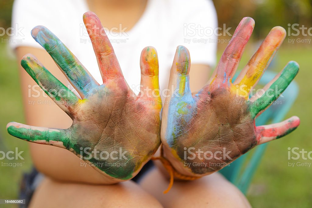 Asian little girl with hands painted in colorful paints royalty-free stock photo
