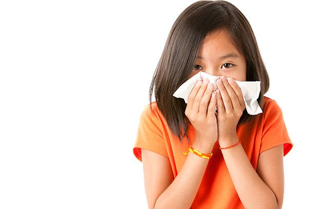Asian Little Girl with the Flu or Allergies Closeup Headshot stock photo