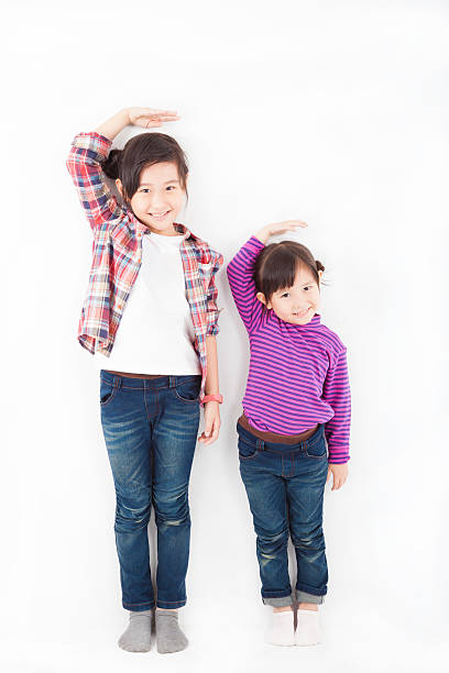asian little girls standing together stock photo