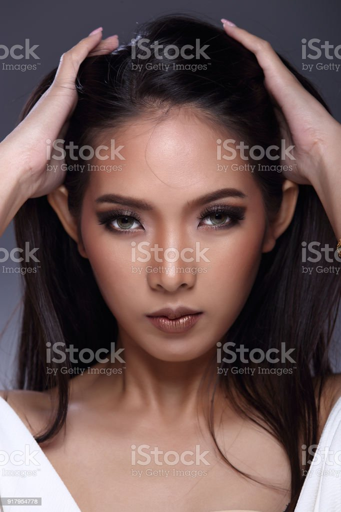 Asian Long Straight Black Hair Tan Skin Woman In Black Dress