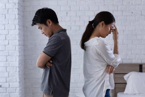 Asian lovers, they are bored and arguing unhappy. stock photo