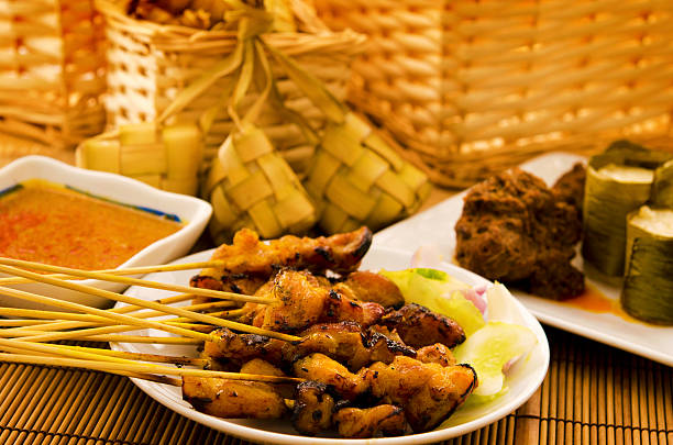 asian malay ramadhan foods - ketupat stock pictures, royalty-free photos & images