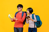 istock Asian male and female students looking at the book 1175607804