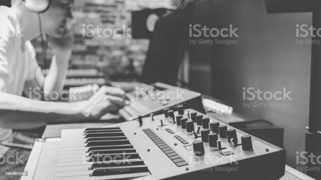 Asian Male Composer Making Music In Home Studio Stock Photo - Download  Image Now