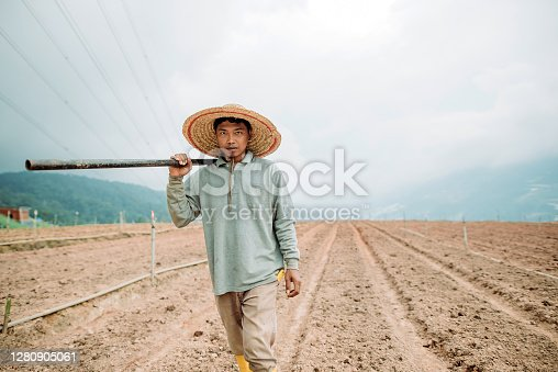 farmer walking and looking at camera